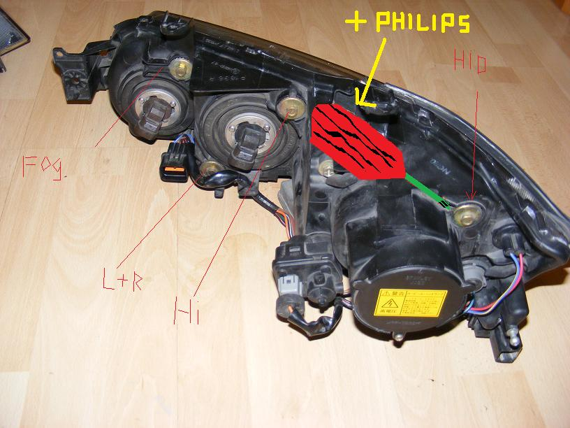 the hid unit,you can see the adjuster motor, if there is a hole in the  top or an allen head somewhere,you could adjust it there too  but fdo it at  your